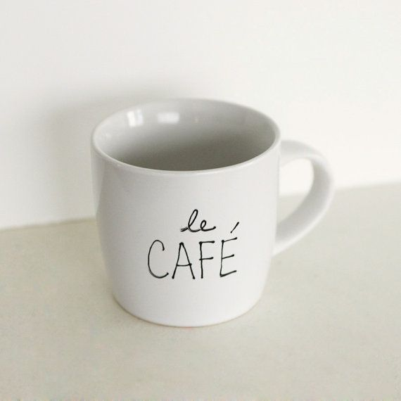 Le Café Mug. This would be so easy to make. Get an unglazed mug, a paint pen, and some glaze? Or does someone have a better idea?