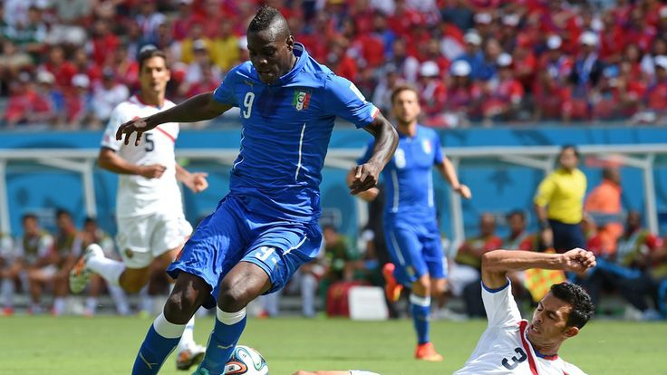 Giancarlo Gonzalez of Costa Rica tackles Mario Balotelli of Italy