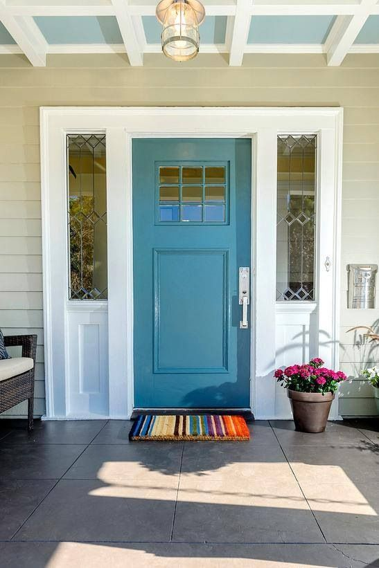 The Little Things Turquoise Front Door Pale Blue Ceiling Colorful Mat And Flowers Make This Entry Stand Out From Hgtv S Curb Eal