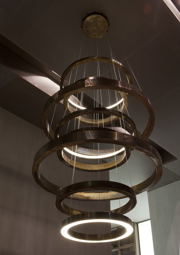 Light ring xxl collection 2012 chandelier consisting of hand burnished brass rings in various
