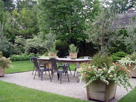 Rectangle Pea Gravel Area For Dining Table With Planters In Corners