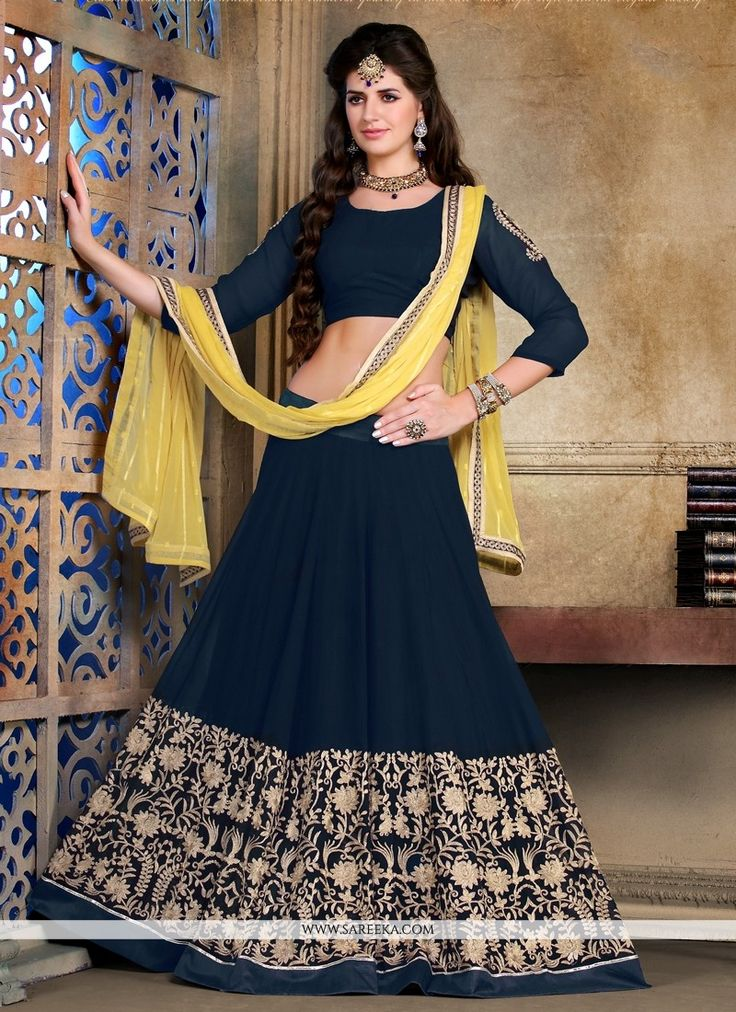 We have ensemble a symphony of enchanting piece to restyle your senses. Be your unique style and design diva with this navy blue georgette a line lehenga choli. The interesting embroidery with embroid...