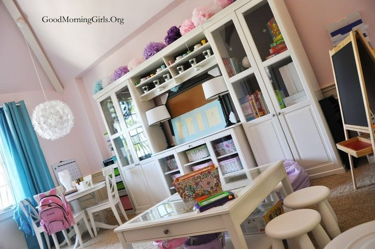 IKEA inspired homeschool room – love all the white furniture and use of huge entertainment stand for storage