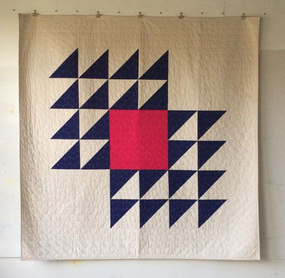 modern minimal decor  Fly Away, a custom quilt made and designed by Heather Jones, was inspired by a traditional quilt block design. This