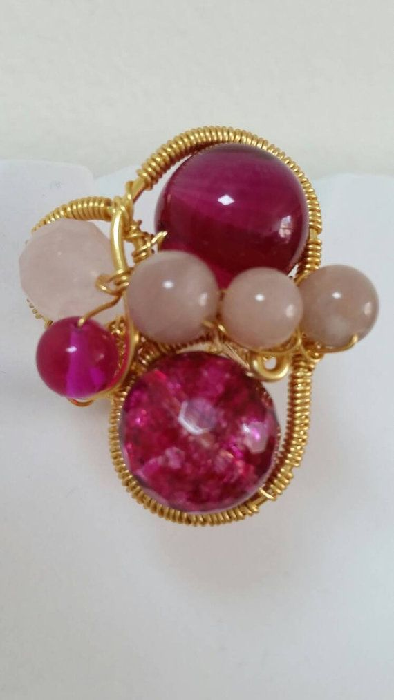 Check out this item in my Etsy shop https://www.etsy.com/uk/listing/286441473/statement-pink-with-gold-plated-wire