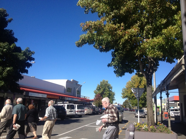 Happy people shopping downtown Rangiora on a superb warm Autumn day