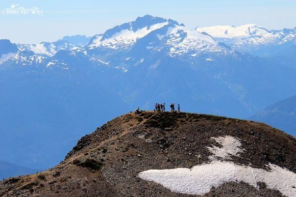 Hikers on Panorama Ridge, the Tantalus Mountain Range Towering Behind