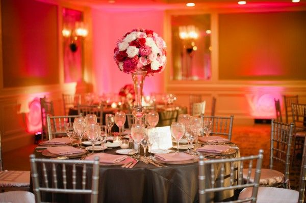 A dreamy ballroom reception with romantic blooms in the prettiest shades of pink captured by Hazelnut Photography!