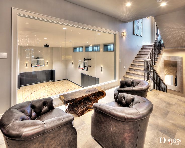This home is full of so much more than meets the eye. Consider, for example, the secret spiral slide tucked into a lower-level bookcase which slips into the basketball court in the sub-basement. Take the stairs or take the slide to shoot some hoops or just expend some extra energy. Spectators can enjoy a bird's eye view of the action from overstuffed leather chairs around a driftwood coffee table. Photo by James Maidhof
