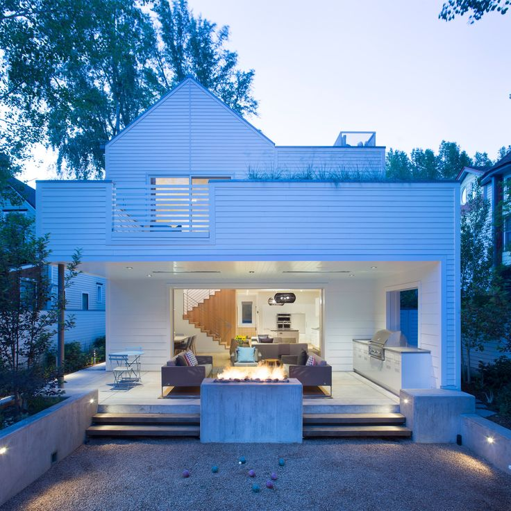 """A lot in Aspen was divided in half to make way for this white, slender home by US studio Rowland + Broughton, which is meant to bring """"a sense of clarity and elegance to a traditionally ornate Victorian form""""."""