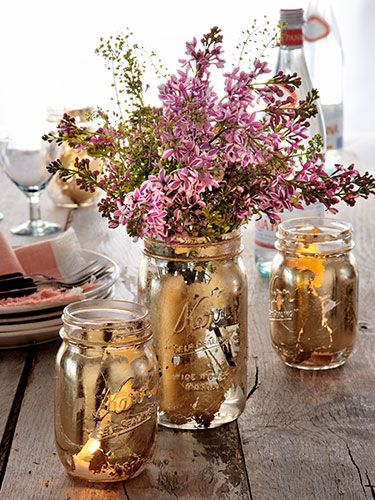Upgrade your dinner table with gilded DIY vases and votives. Use a foam brush to apply adhesive to the outside of a mason jar in small, irregular patches. When the sticky substance turns clear—in about 30 minutes— press on sheets of gold leaf. Then, rub away excess flecks with a paper towel for a lovely weathered patina.