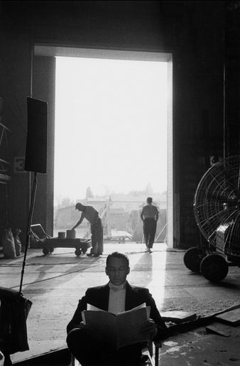 Frank Sinatra sitting in an open doorway on the 20th Century Fox Studios soudstage, 1959, by Bob Willoughby