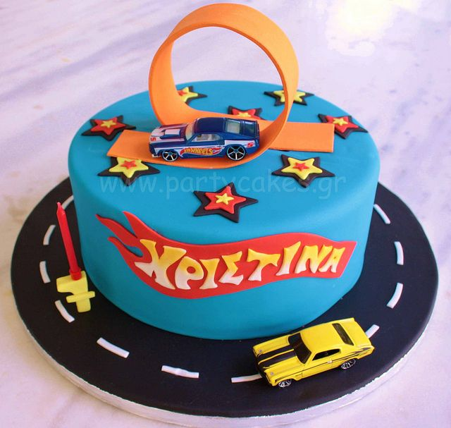 hot wheels cake. love the loop! maybe put his name on the flame logo?!