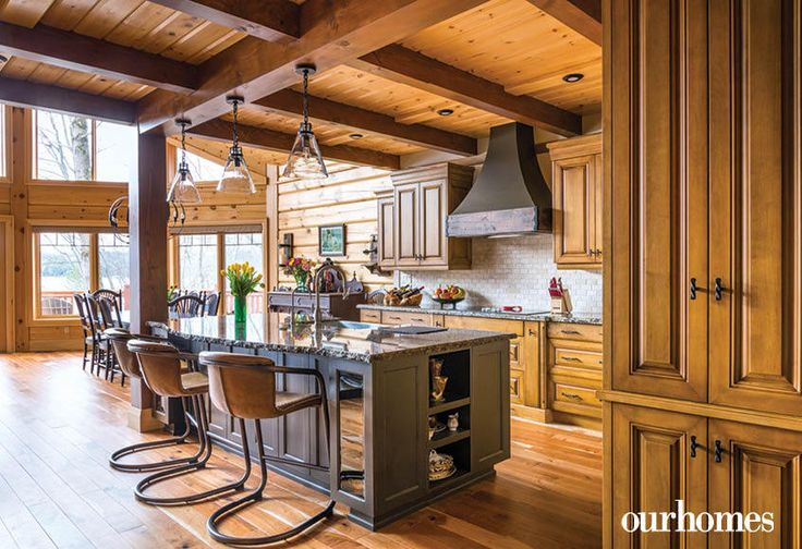 """Maple cabinetry was built and installed in the kitchen. Granite covers the countertops and island.    See more of this home in """"Fifth Generation Legacy on Muskoka's Moon River"""" from OUR HOMES Muskoka Early Summer 2017: http://www.ourhomes.ca/articles/build/article/fifth-generation-legacy-on-muskokas-moon-river"""