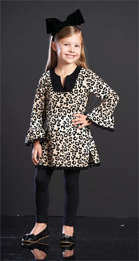 Corduroy tunic can be worn as dress or over leggings and features leopard pattern, contrasting neckline and pom-pom trim. #mudpiegift