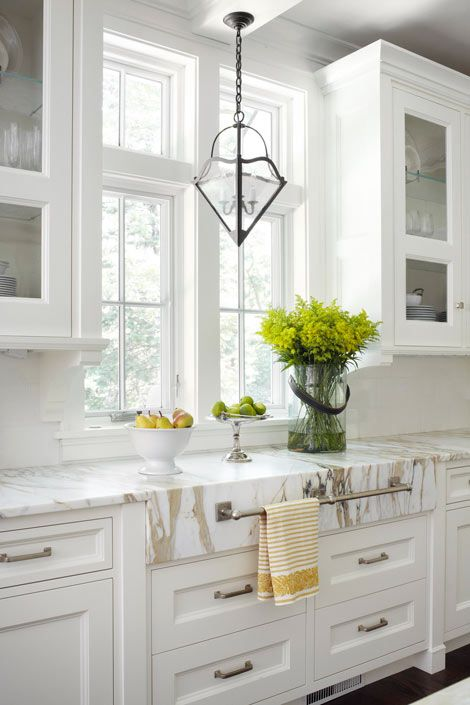 Calacatta Gold marble countertop. Forgo the typical grey-veined marble to add warmth to a classic kitchen. Works with either nickel/silver or brass hardware. Photographs: Werner Straube Design: Rosemary Merrill