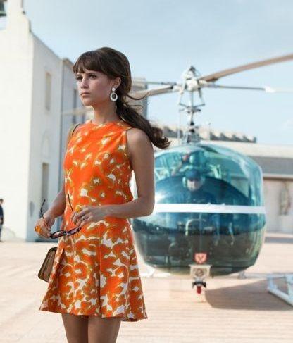 'The Man From U.N.C.L.E.' - Alicia Vikander wears an orange print dress with a flared hemline as Gaby