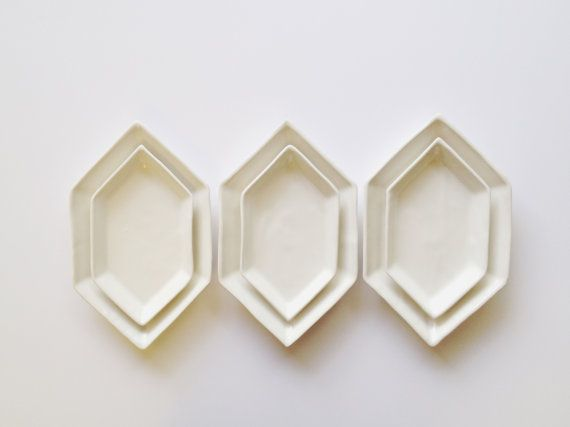 Simple. Classy. Geometric. These dishes are hand made, designed as nesting serving dishes, however they also function wonderfully as a spoon rest and catch all jewelry dishes. Set retail value is $74 - Discounted 20% when purchasing this set. The small measures 9.5 x 5.25 x .75  The medium measures 12 x 7.25 x 1.25