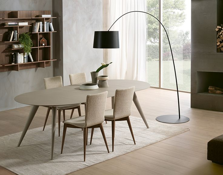 Photo of Round extendable dining table with solid wood legs.