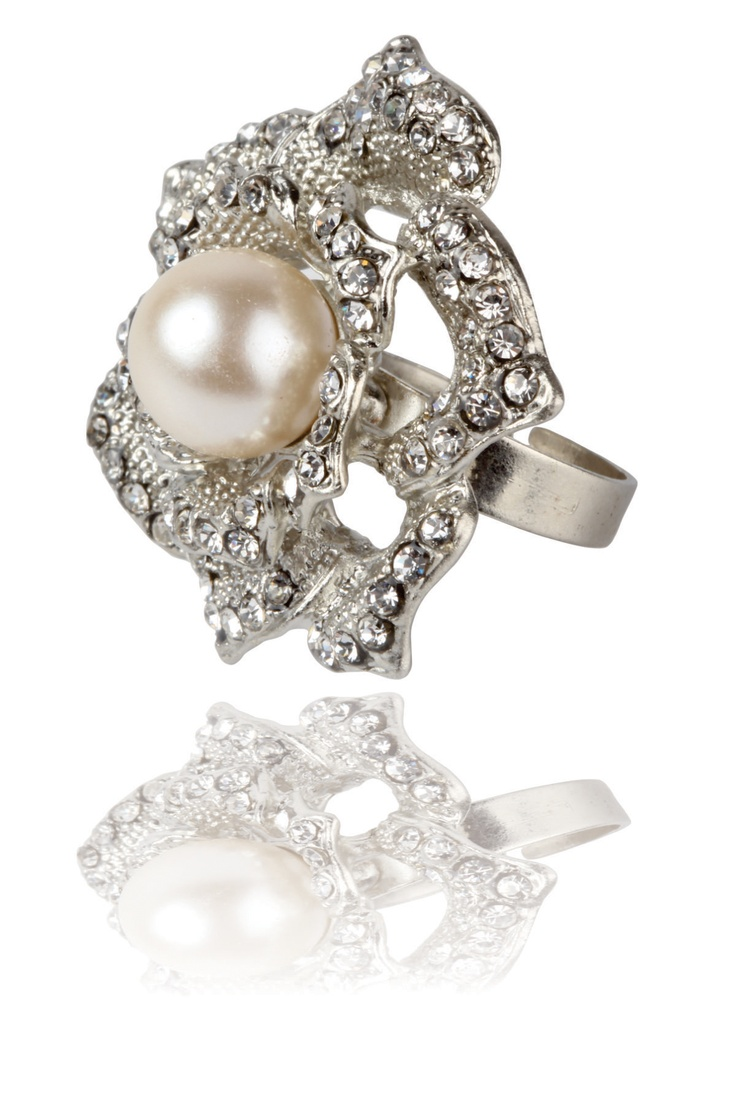 Flower Power Cocktail Ring -    Statement ring with a pearl at the center, special crystals embossed into the metal wiring,  Adjustable and easy to wear, sits comfortablaly around the finger...... - Rs. 499.00