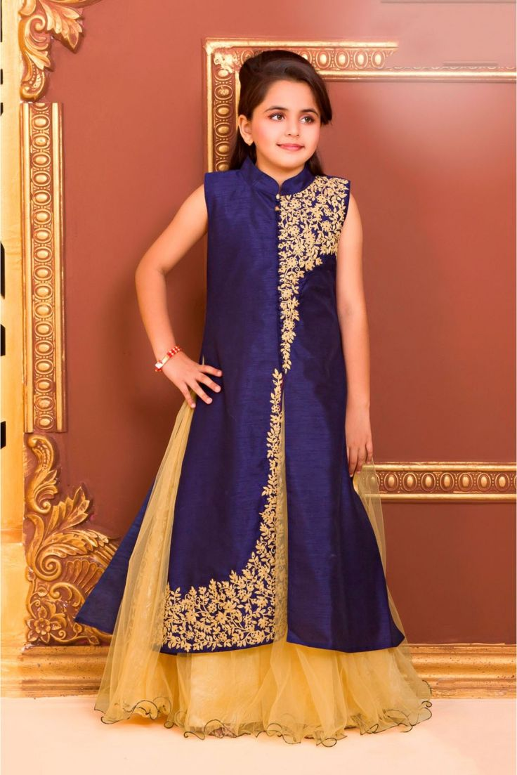 Dress up your little diva in a plush Polyester And Satin Lehenga Suit. The Navy Blue colour of the looks charming and pretty. This Lehenga Suit will make your dear little angel look adorable for any s...