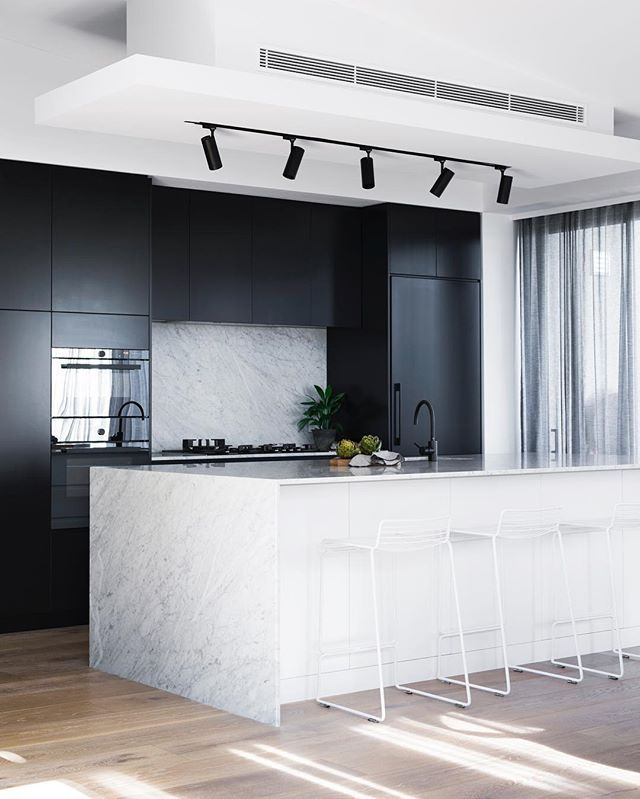 The inspiration for our kitchen - dark cabinets, light marble island and black track lighting.