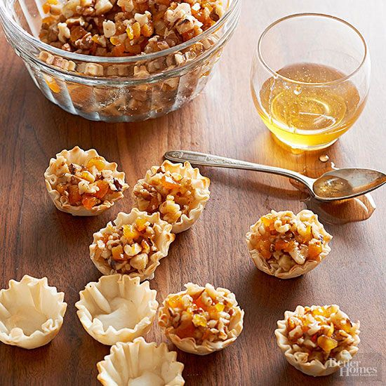 32 25 minute apps These crunchy walnut mini tarts are bound to become a finger-food favorite for holiday guests. A trio of crystallized ginger, honey, and nutmeg flavors these petite, fruit-and-nut-filled phyllo treats. Bonus! If you don't have 10 minutes to spare, prepare these appetizers up to 48 hours in advance.