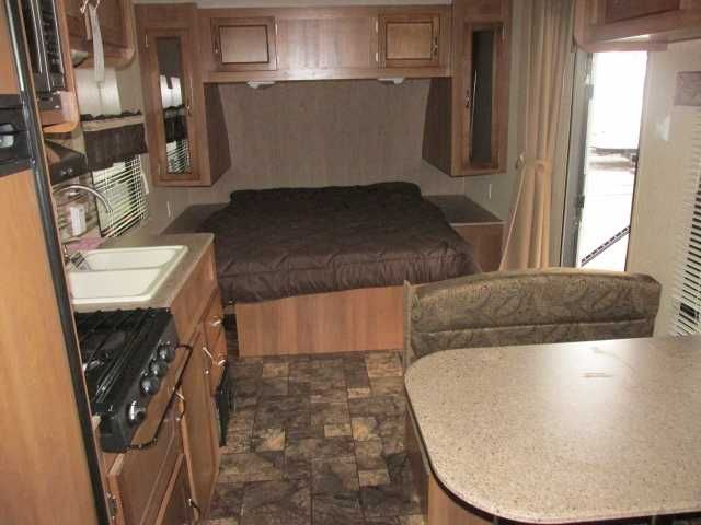 2016 New Coachmen Catalina 213BH Travel Trailer in Georgia GA.Recreational Vehicle, rv, This unit is the smallest Catalina available with plenty of room in a 21 foot box size. There is a queen bed in the front, a dinette that makes a bed, and a double/twin bunk set in the rear.This RV is furnished with:-Shower Surround-Patio Awning-TV Antenna-Satellite Ready-Multi Media Sound System-Outside speakers-Camel Decor-6 gal DSI water heater-Double Door refrigerator-Range-Microwave-Bunk…