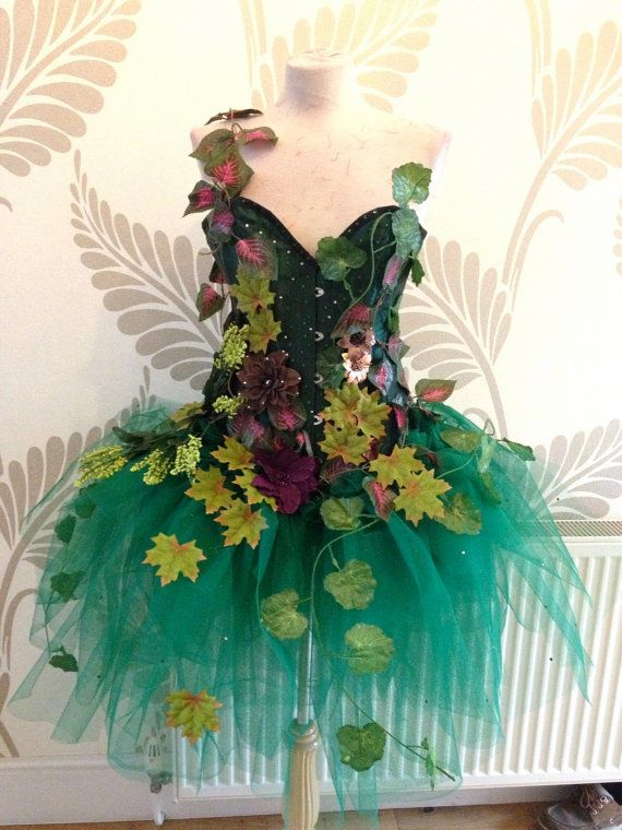 Gorgeous Adult Forest Fairy Costume.  Costume Description:  Fully steel boned green satin over bust corset adorned with sparkly diamantes