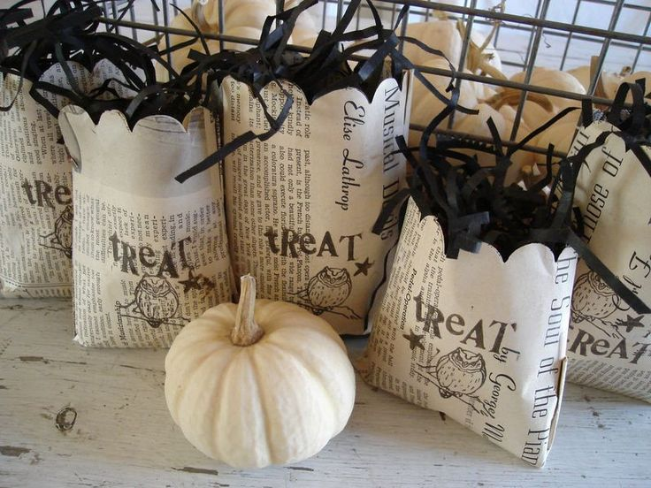 treat bags ... love this idea of newspaper and black stamping on these gift bags for any holiday or occasion :)