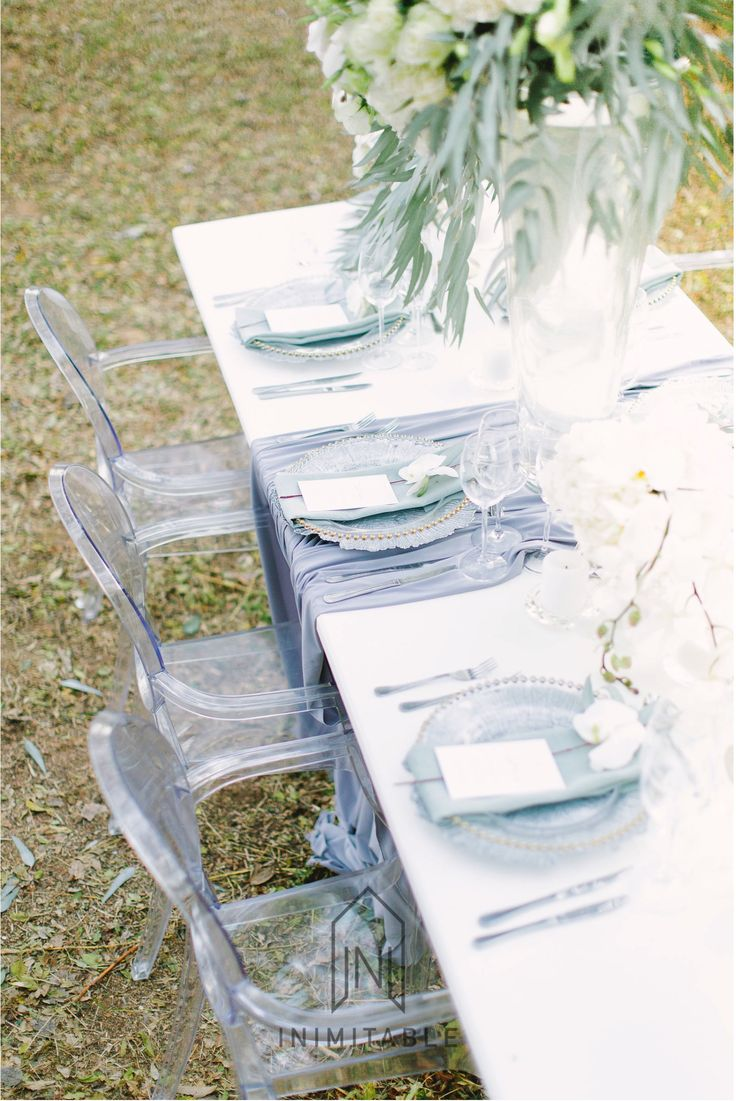 Elegant wedding table: Photography: @genevieve_fundaro  Hair and Make-up: @refinerythe  Dress: @calegrabridal  Floral Design: @zavionkotzeeventscompany  Venue: @inimitable_wv   #luxury #luxuryvenue #luxeweddings #luxewedding #flowerwall #allwhite #bride #bridal #floraldesign #bouquet grey, green, white, flowers, floral, wedding day
