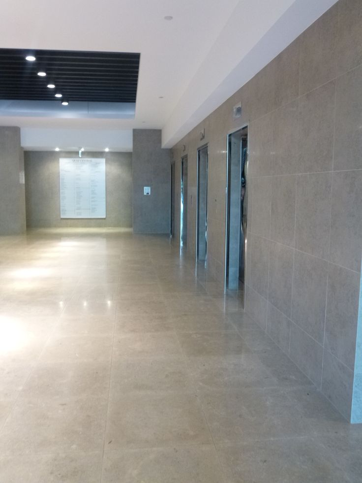 Commercial business lobby - aim was to choose a tile matching the limestone floor.