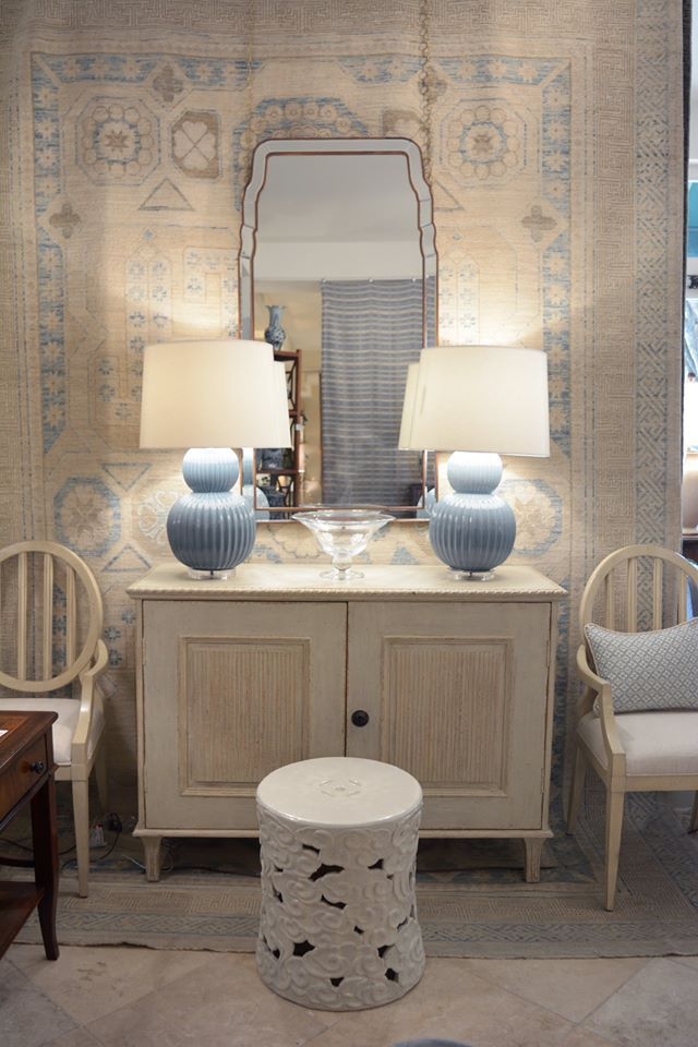 White sideboard with matching blue lamps with white shades at the kellogg collection dc shop