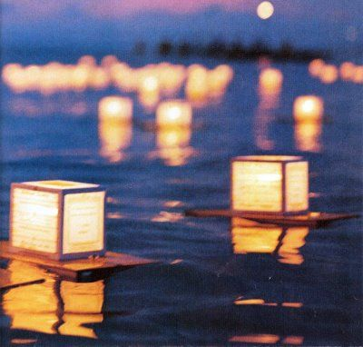 floating water lanterns for wedding lakeside