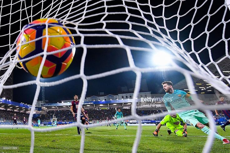 Lionel Messi of FC Barcelona scores his team's second goal during the La Liga match between SD Eibar and FC Barcelona at Ipurua stadium on January 22, 2017 in Eibar, Spain.