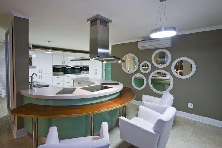 White granite kitchen top, white chairs