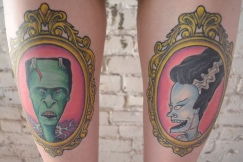 beavis and bolt-head framed thigh tattoos.