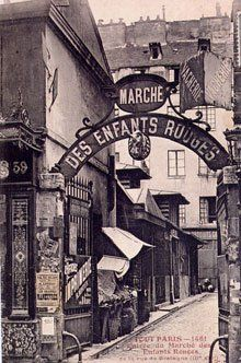 """Le Marché des Enfants Rouges #Paris 3"""" At 33bis Rue Charlot, you'll see a small gate with a sign announcing the entrance to the small Marche des Enfants Rouges, a covered market lined with food stalls."""" (CW11-5)"""