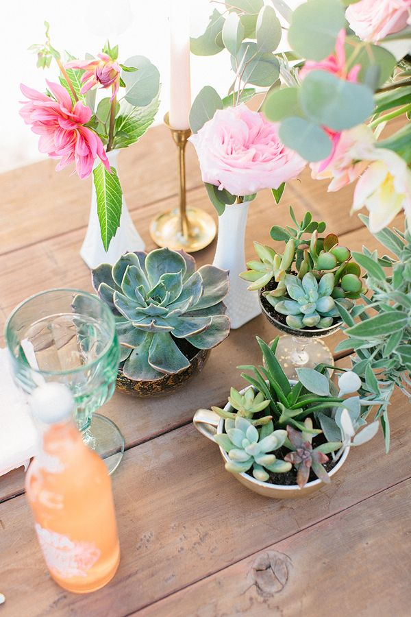 Succulents in tea cups mixed with spring blooms.