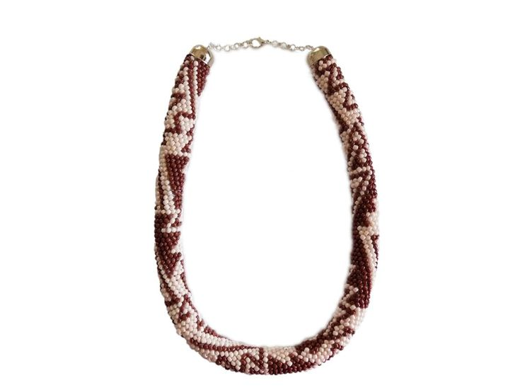 Beaded necklace crochet - Knitted crochet necklace shaped snake with 14 stitches per round from about 2 mm glass beads one and cotton thread in shades of beige and brown. The cotton thread do what flexible and comfortable to be worn round the neck.