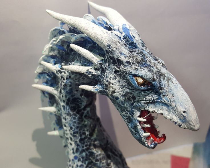 Water Dragon made from sculpey clay, silicone glue, acrylic paint and all-purpose sealant.