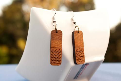 Aztec-style engraved rimu earrings - $35