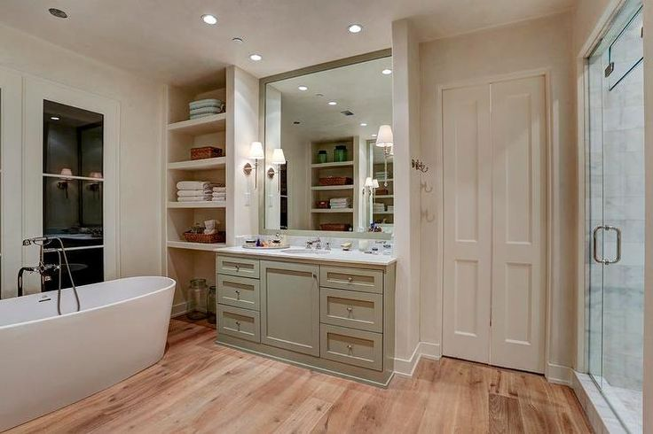 Chic Cottage Bathroom Features A Gray Green Vanity Topped