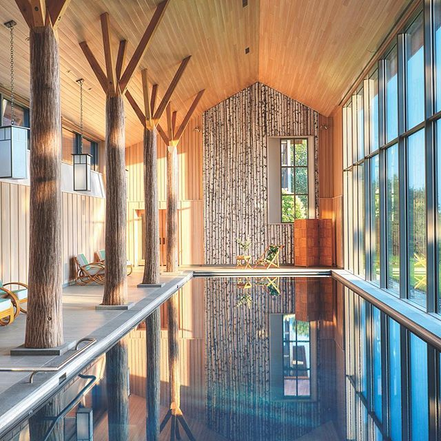A secret pool house in upstate New York by @BarlisWedlick Architects features a white-oak tree-trunk colonnade spanning the length of the 54-foot-pool, forging the fantasy of being outdoors. : Reto Guntli. #architecture #interior #design #interiordesign #house #poolhouse #homes #IDhomes