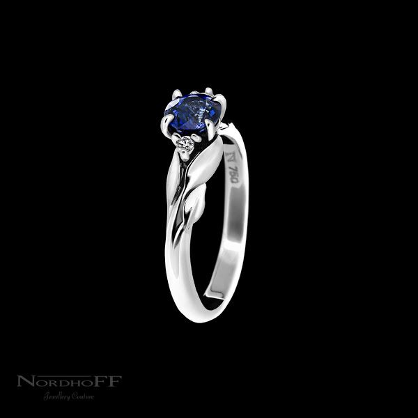 The bright blue Ceylon sapphire is just breathtaking sitting at the centre of this organic ring. The last finishing touches of this entirely handmade ring was for Sam to painstakingly cut and sculpt each individual leaf out of white gold, shaping and curving every one and blending each stalk to weld seamlessly with the branched band.