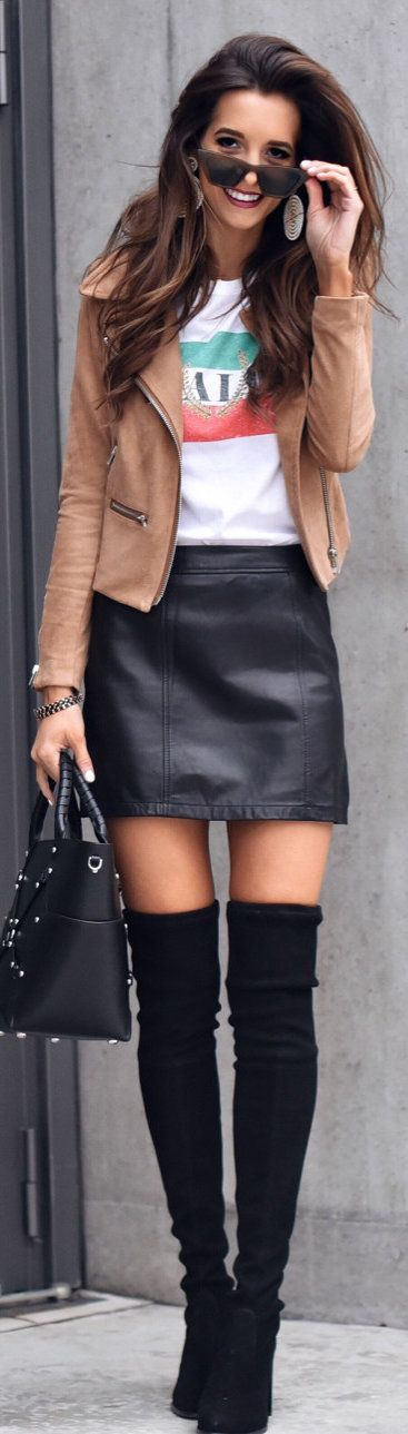#spring #outfits woman wearing brown zip-up jacket and black leather skirt. Pic by @myviewinheels