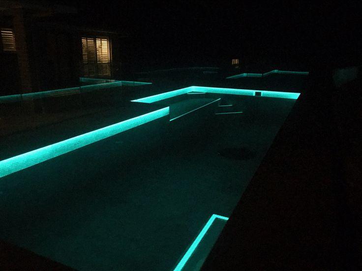 Amber Tiles Kellyville: pinned from Instagram @ambertiles_maroochydore. on Instagram: Aqua glow water line tiles #poolinspiration #poolmosaic #mosaic #glowmosaic #glowinthedark #ambertiles #ambertileskellyville