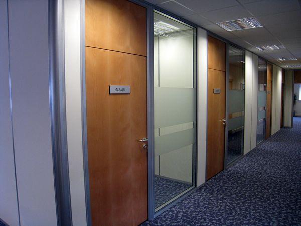 Relocatable partitioning overpanel doors