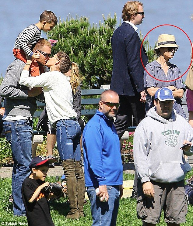 Awkward! New England Patriot Tom Brady plants a big kiss on wife Gisele Bundchen as they flaunt their love in front of his ex actress Bridget Moynahan the mother of his first son.