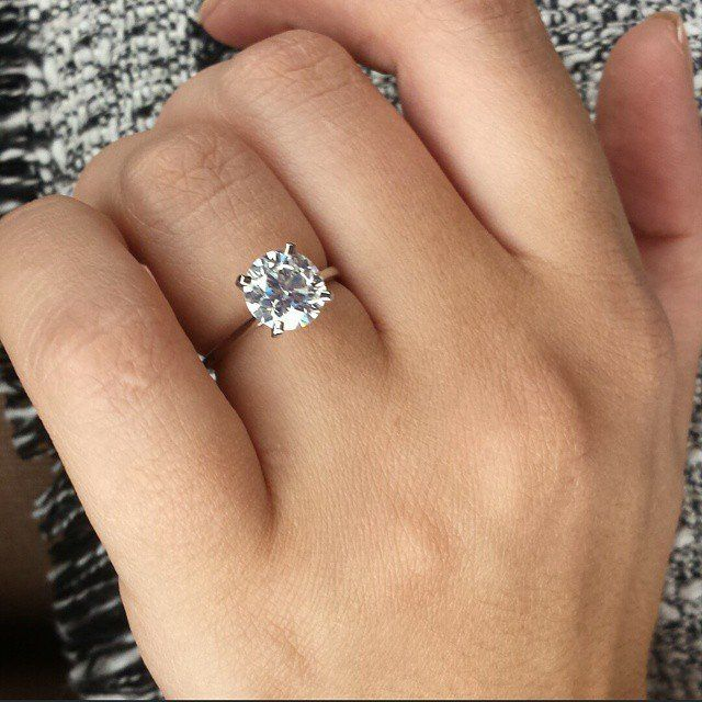 My dream ring!! Round solitatire or cushion cut. Nothing on the band  ring goals